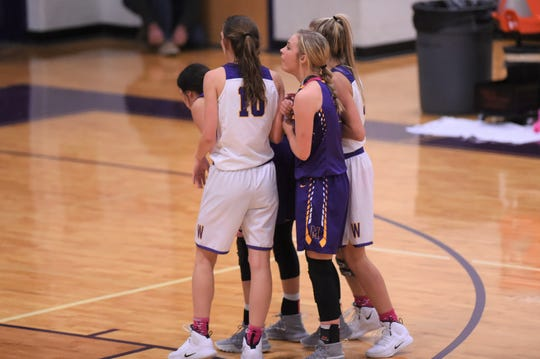 Wylie's Abbey Henson (10) and Emma Melton (5) set up a defensive press against Merkel in the Coaches vs. Cancer Pink Out game on Tuesday, Dec. 4, 2018. The Lady Bulldogs won 75-39.