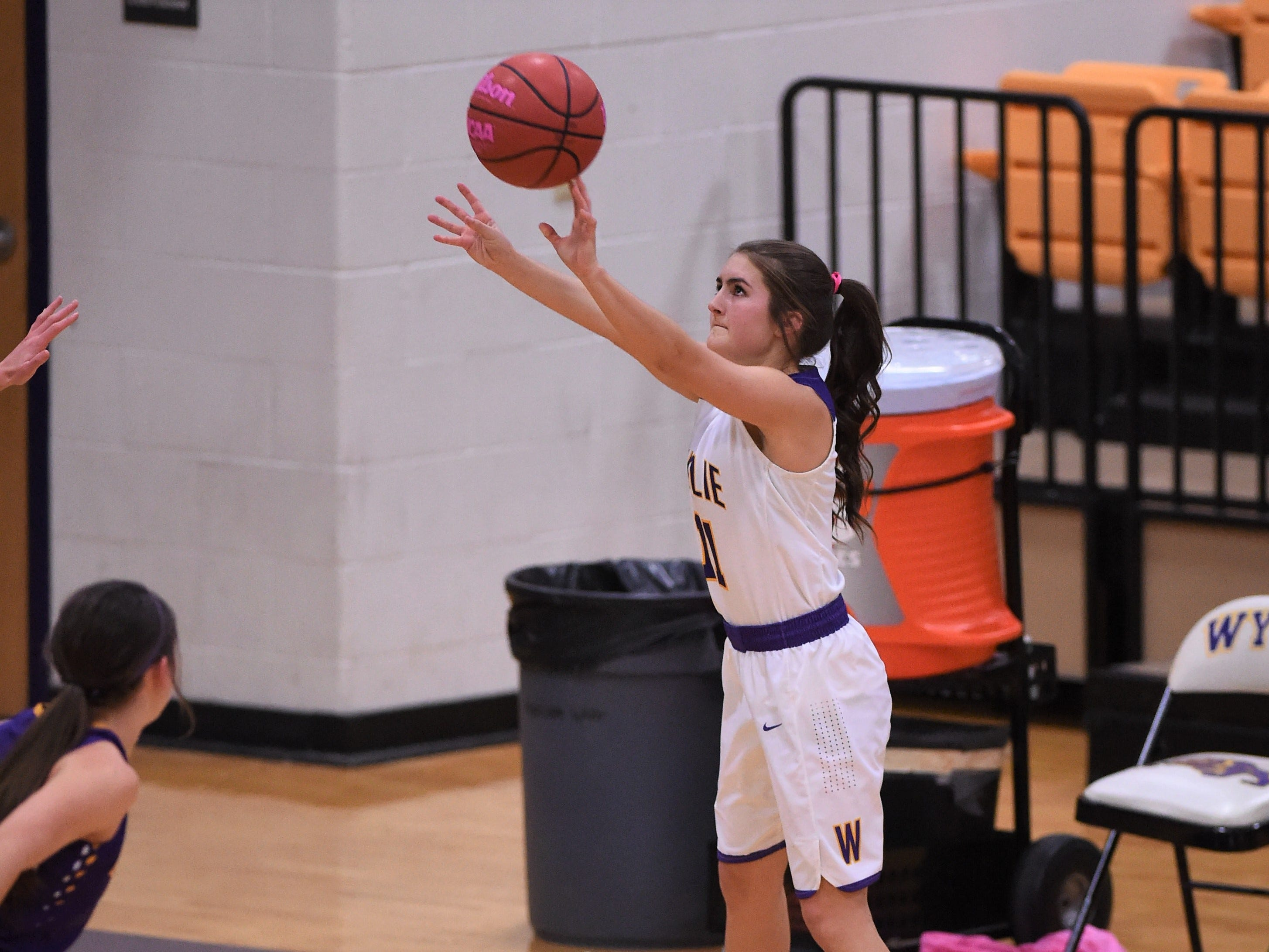 Wylie guard Madi Latham (11) takes a 3-point shot against Merkel in the Coaches vs. Cancer Pink Out game on Tuesday, Dec. 4, 2018. The Lady Bulldogs won 75-39.
