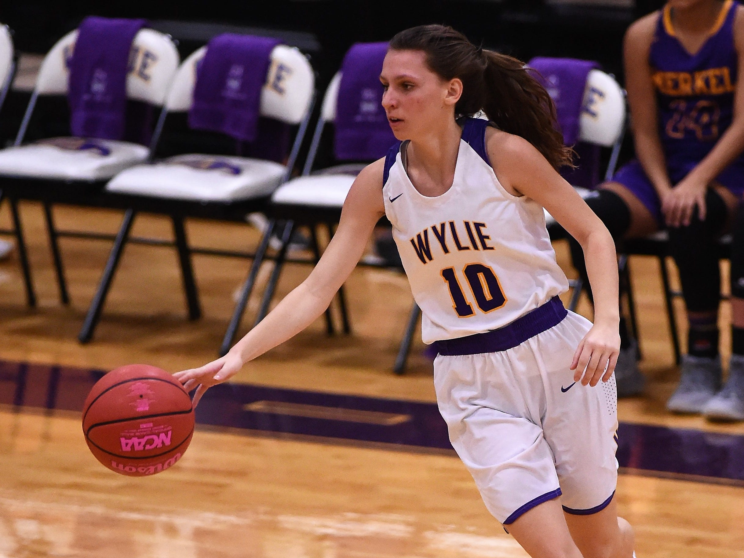 Wylie's Abbey Henson (10) turns with the ball against Merkel in the Coaches vs. Cancer Pink Out game on Tuesday, Dec. 4, 2018. The Lady Bulldogs won 75-39.