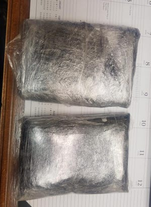 A Cisco Police Department officer found two packages of heroin totaling 5 pounds 6 ounces during a traffic stop on Interstate 20 on Tuesday.