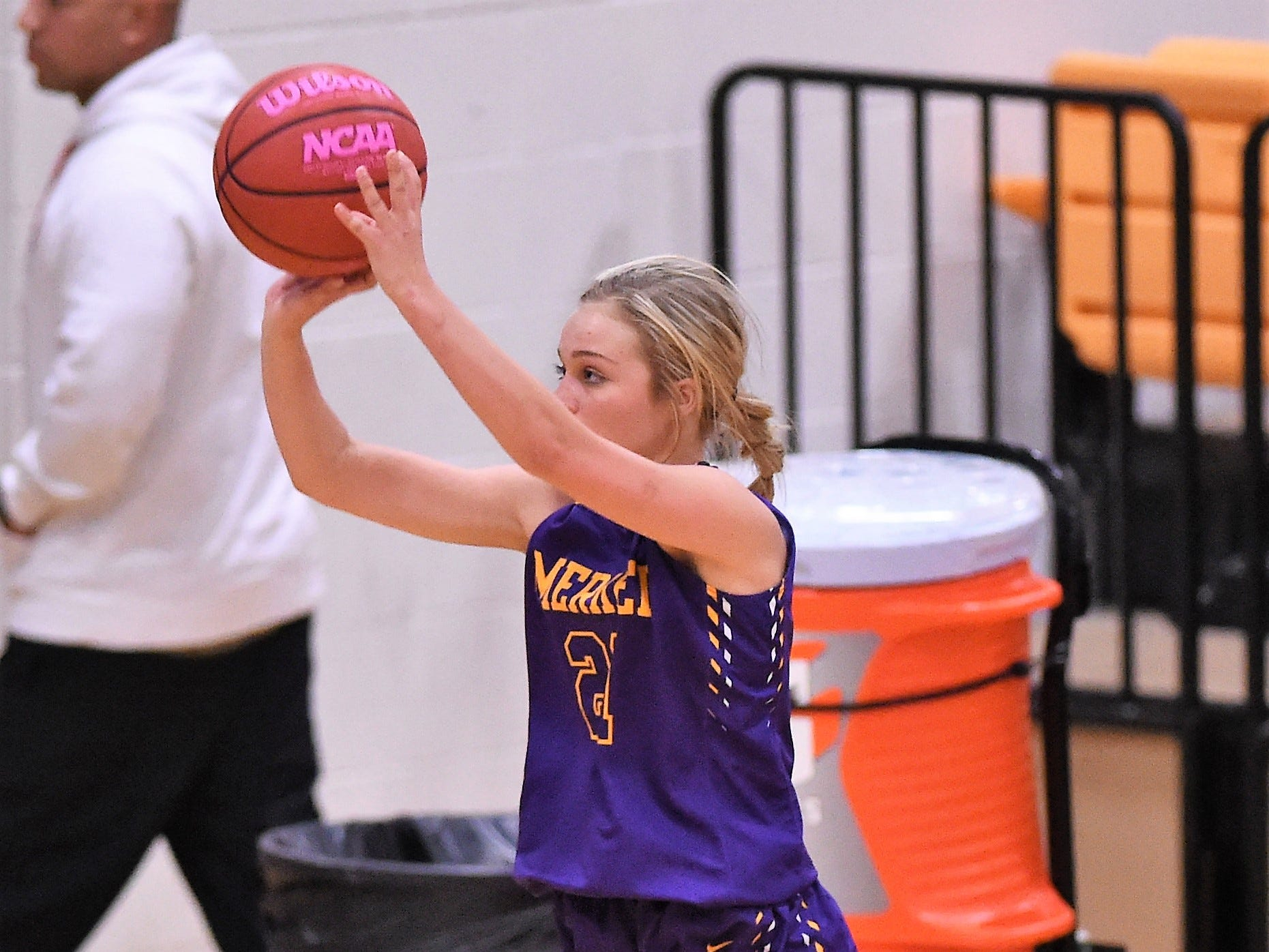 Merkel's Kinzi Hays (21) takes a 3-point shot against Wylie in the Coaches vs. Cancer Pink Out game on Tuesday, Dec. 4, 2018. The Lady Bulldogs won 75-39.