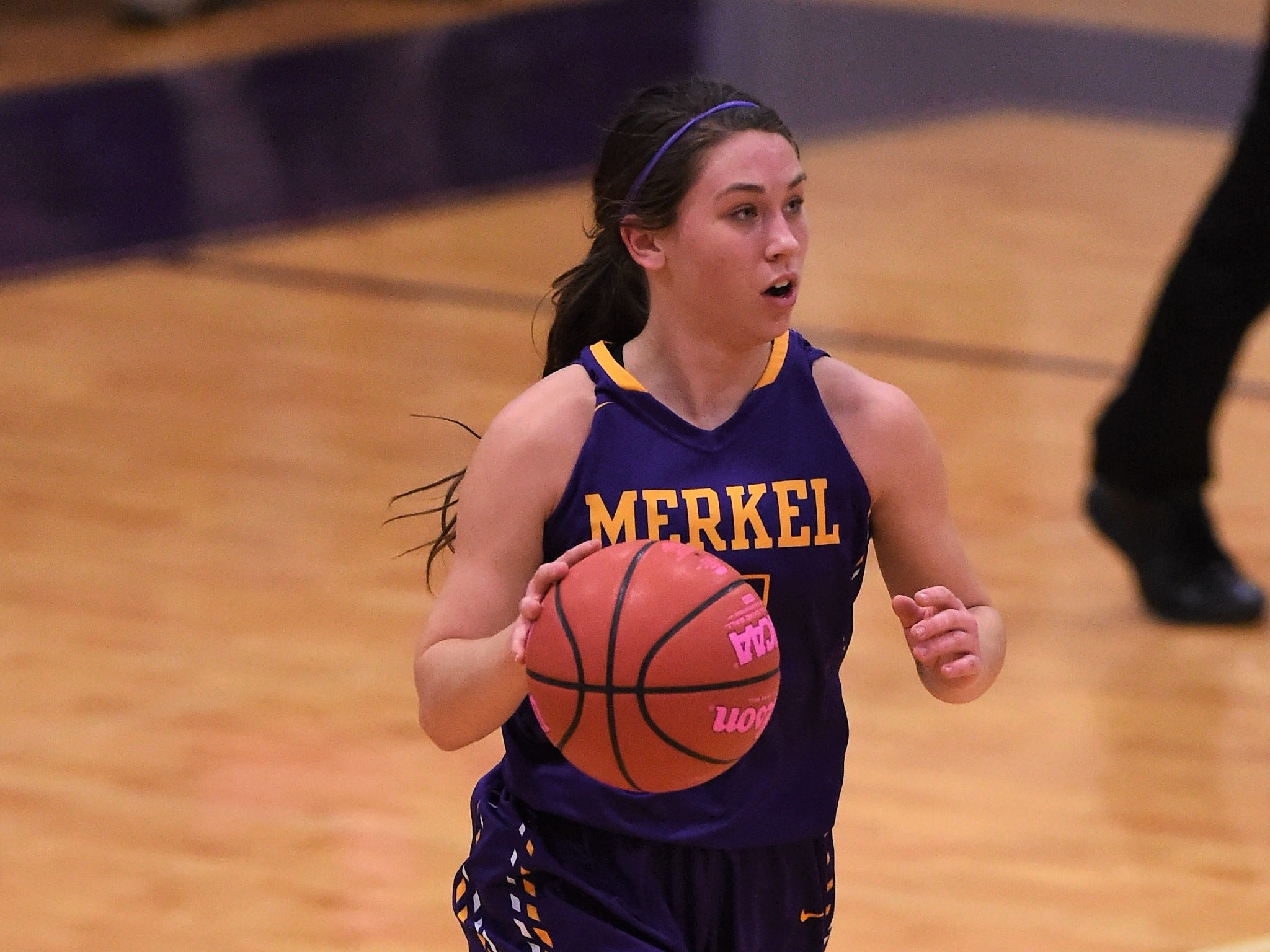 Merkel's Kaydi Pursley (11) brings the ball down court against Wylie in the Coaches vs. Cancer Pink Out game on Tuesday, Dec. 4, 2018. The Lady Bulldogs won 75-39.