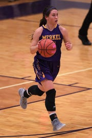 Merkel's Kaydi Pursley (11) brings a special pink basketball down the court against Wylie in the Coaches vs. Cancer Pink Out game last Tuesday. The two teams came together for Coaches vs. Cancer to benefit a member of the Wylie community.