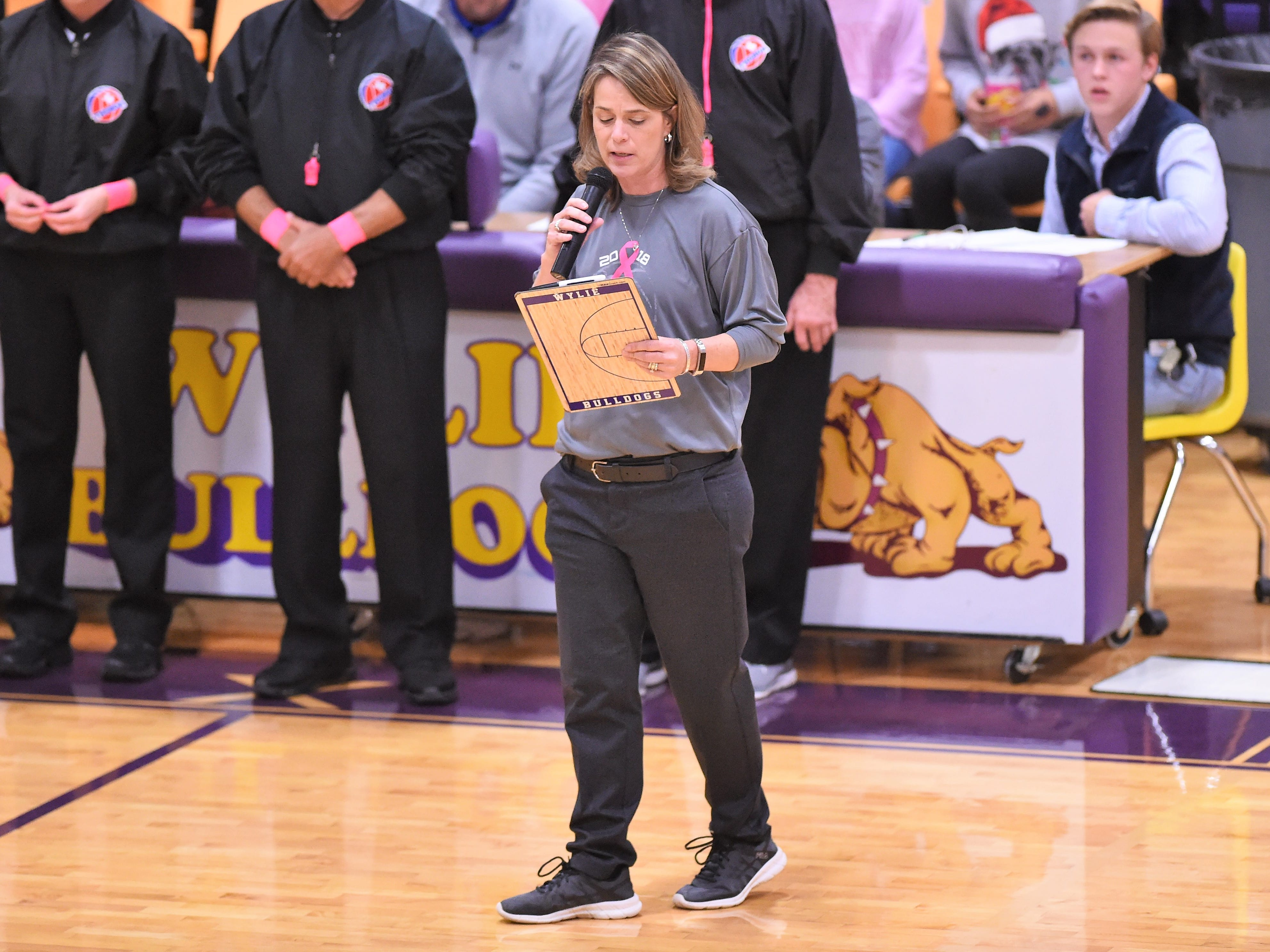 Wylie coach Amy Powell speaks before the Lady Bulldogs faced Merkel in a Coaches vs. Cancer Pink Out game at Bulldog Gym on Tuesday, Dec. 4, 2018.