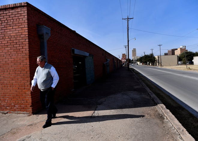 Tom Rose returns to his vehicle after taking a look at the Cotton Warehouse Wednesday in downtown Abilene. Located at 602 N.1st. St., the building, which occupies an entire city block, is up for sale and was open Wednesday for viewing.
