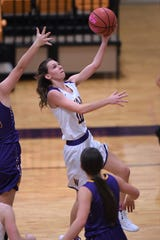 Wylie guard Abbey Henson (10) goes around a Merkel defender for a lay-up in the Coaches vs. Cancer Pink Out game on Tuesday, Dec. 4, 2018. The Lady Bulldogs won 75-39.