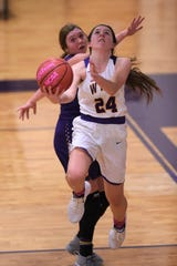 Senior guard Mary Lovelace (24) was a starter for Wylie's run to the Region I-4A final a season ago. As one of eight seniors on the Lady Bulldogs roster this season, Lovelace will be a key as District 4-5A play begins Friday.