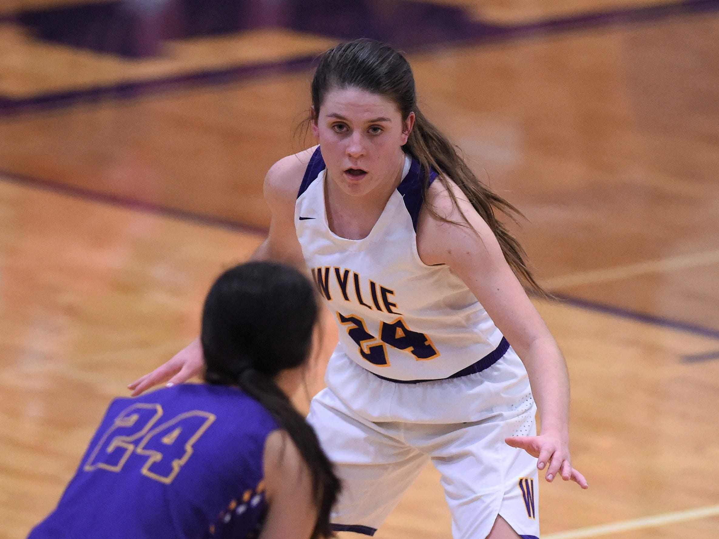 Wylie guard Mary Lovelace (24) guards Merkel's Alyssa O'Malley (24) in the Coaches vs. Cancer Pink Out game on Tuesday, Dec. 4, 2018. The Lady Bulldogs won 75-39.