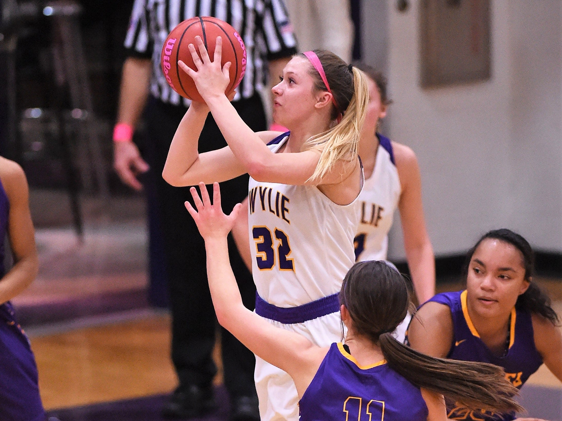 Wylie's Skylar Williams (32) takes a mid-range jumper against Merkel in the Coaches vs. Cancer Pink Out game on Tuesday, Dec. 4, 2018. The Lady Bulldogs won 75-39.