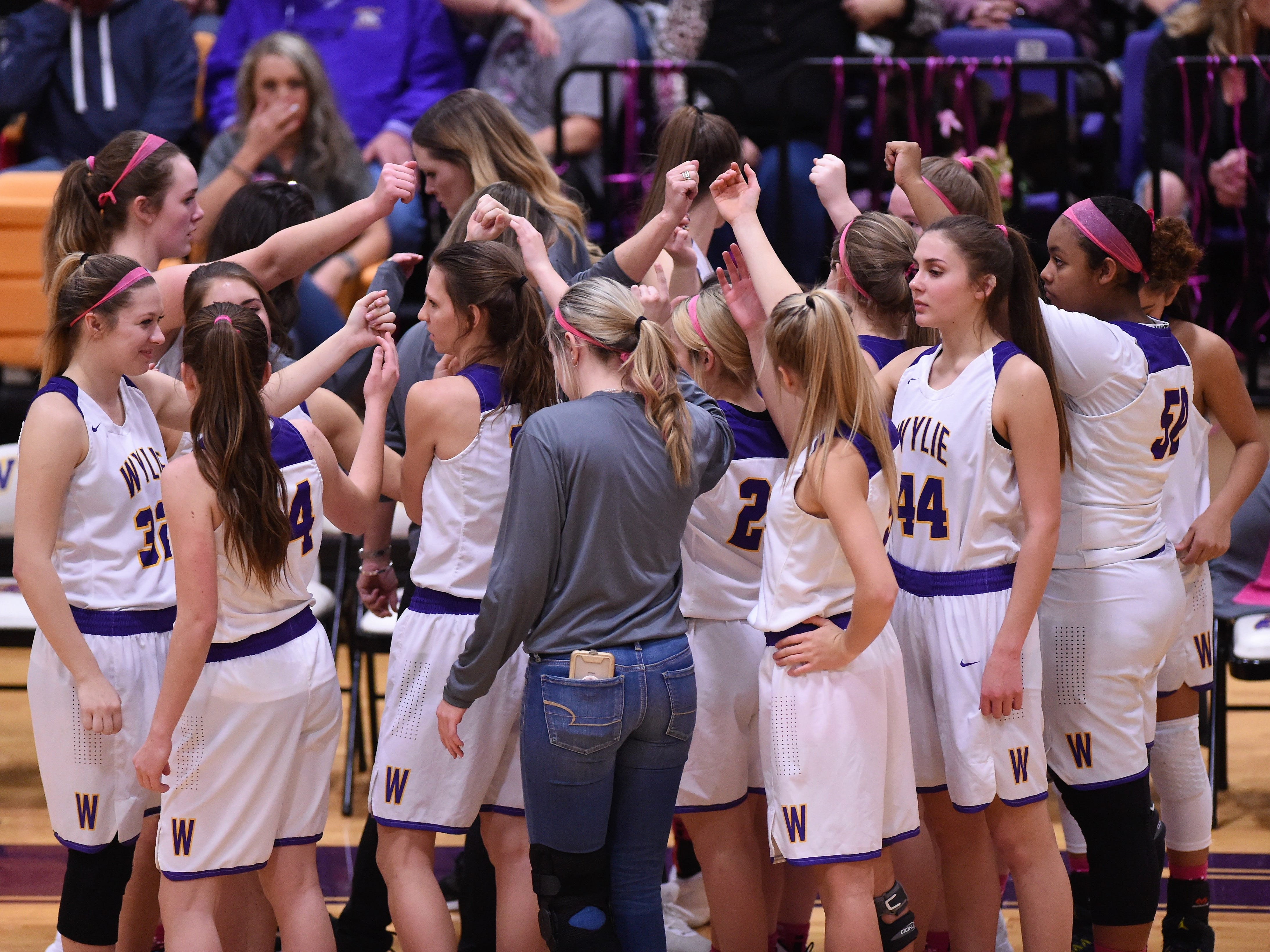 The Wylie girls basketball team breaks a huddle before facing Merkel in a Coaches vs. Cancer Pink Out game on Tuesday, Dec. 4, 2018. The Lady Bulldogs won 75-39.