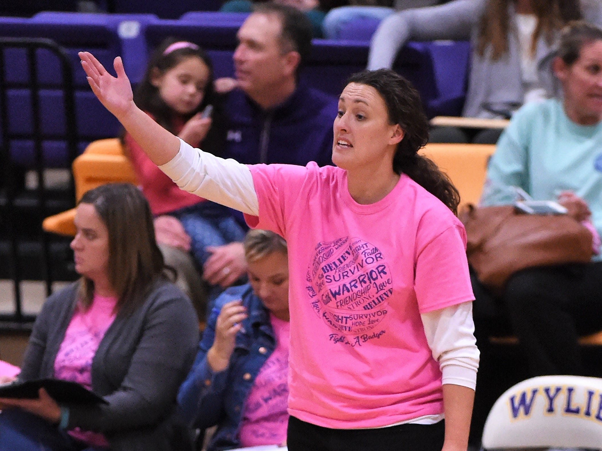 Merkel coach Laura Lange talks to her team from the sideline against Wylie in the Coaches vs. Cancer Pink Out game on Tuesday, Dec. 4, 2018. The Lady Bulldogs won 75-39.