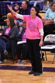 Merkel coach Laura Lange talks to her team from the sideline against Wylie in the Coaches vs. Cancer Pink Out game on last Tuesday.