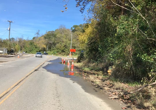 Traffic cones have been in place for weeks along Riverside Drive because of a water leak.