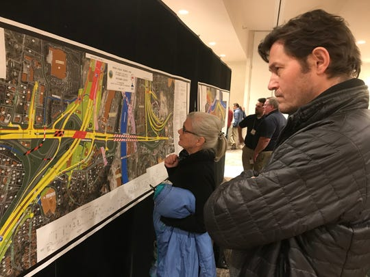 Area residents look over maps of current plans for the I-26 Connector at a public meeting held by the state Department of Transportation Tuesday.