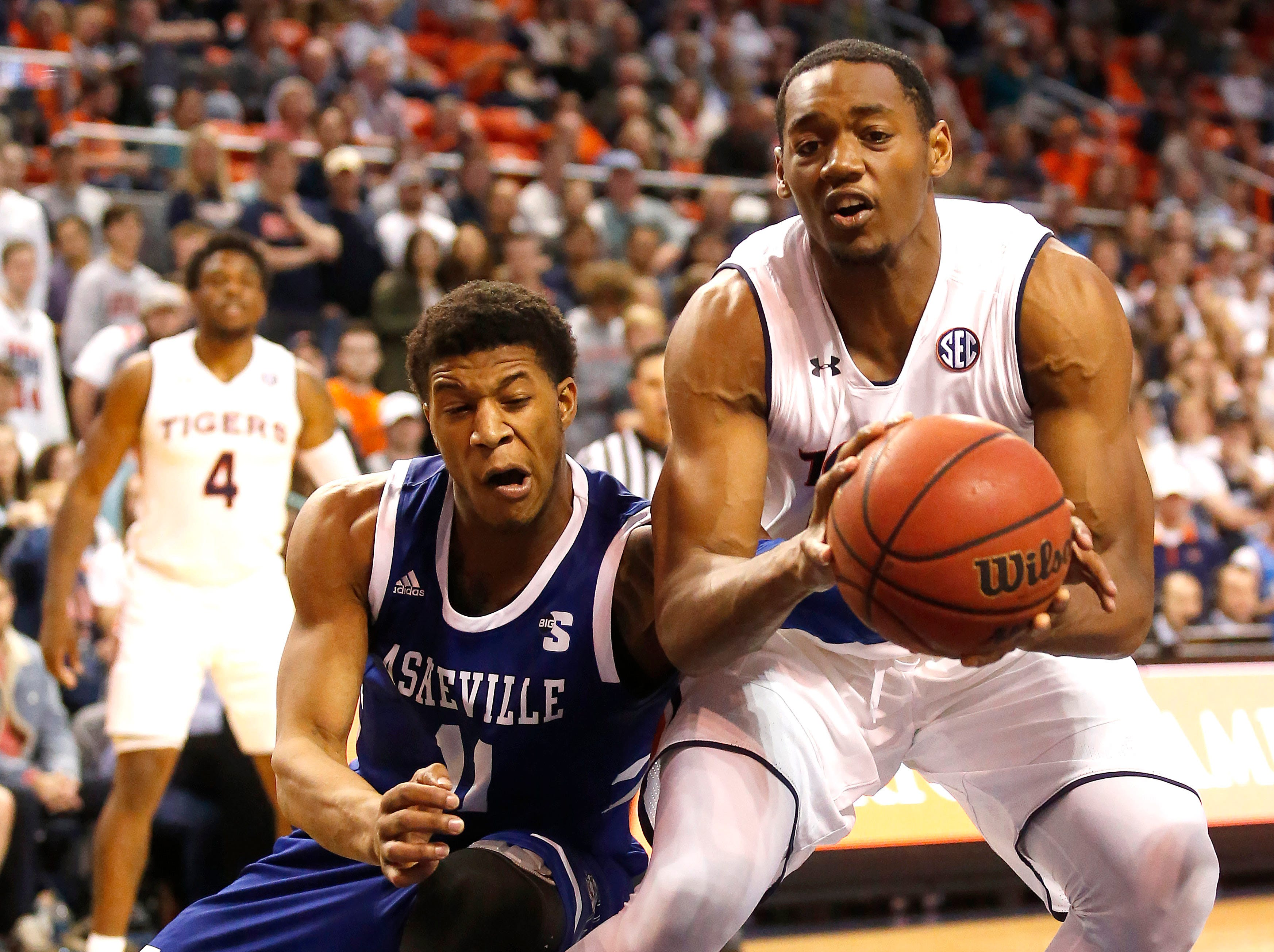 Dec 4, 2018; Auburn, AL, USA; Auburn Tigers center Austin Wiley (50) is fouled by UNC-Asheville Bulldogs guard Jalen Seegars (11) during the second half at Auburn Arena. Mandatory Credit: John Reed-USA TODAY Sports