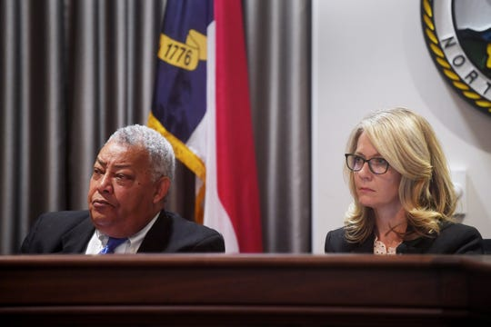 Buncombe County commissioners Al Whitesides and Amanda Edwards listen during the last Board of Commissioners meeting of 2018 on Dec. 4 in Asheville. It was the first regular meeting since Edwards was elected District 2 commissioner.