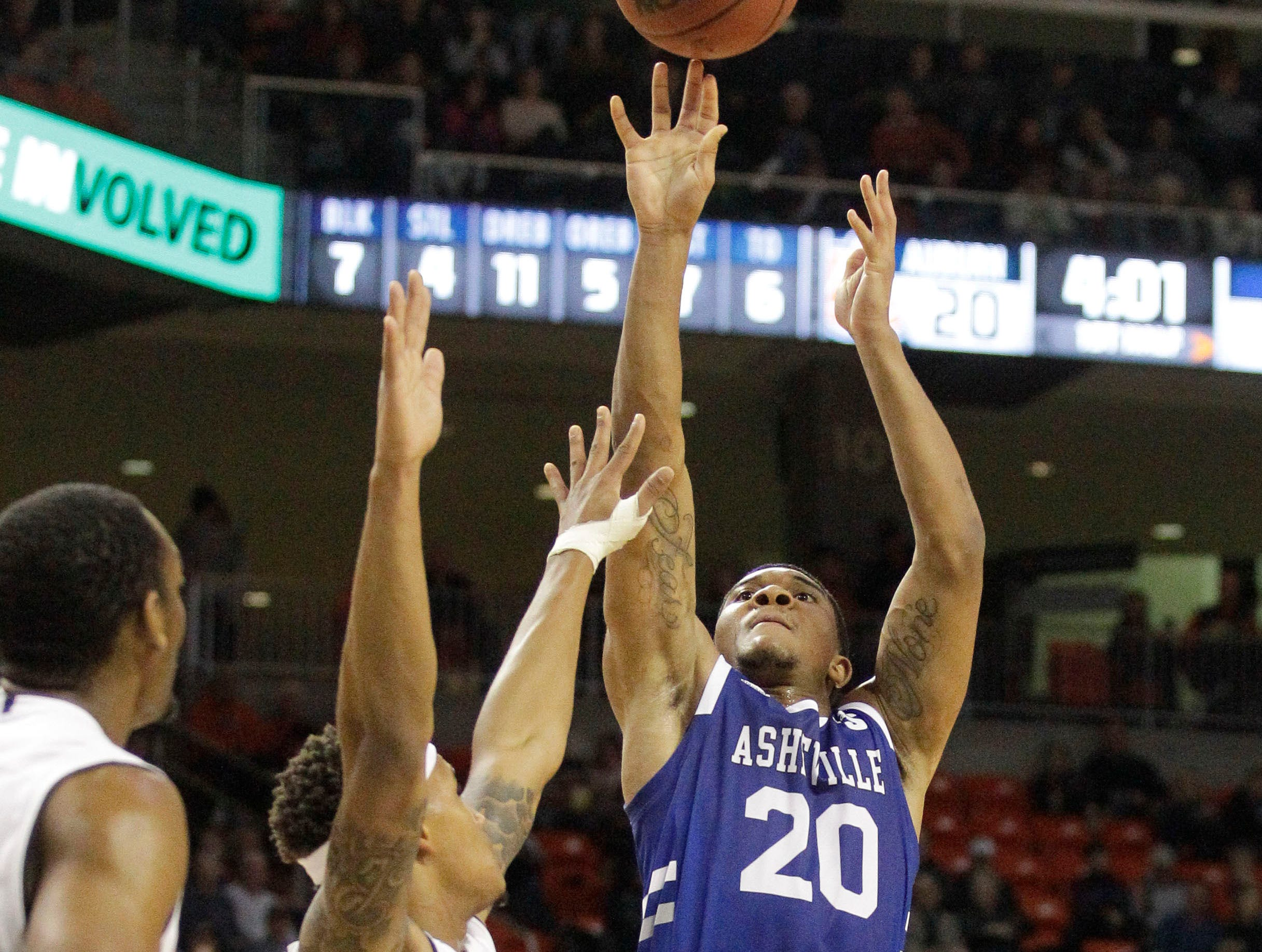 Dec 4, 2018; Auburn, AL, USA; UNC-Asheville Bulldogs guard DeVon Baker (20) shoots over Auburn Tigers guard Bryce Brown (2) during the first half at Auburn Arena. Mandatory Credit: John Reed-USA TODAY Sports