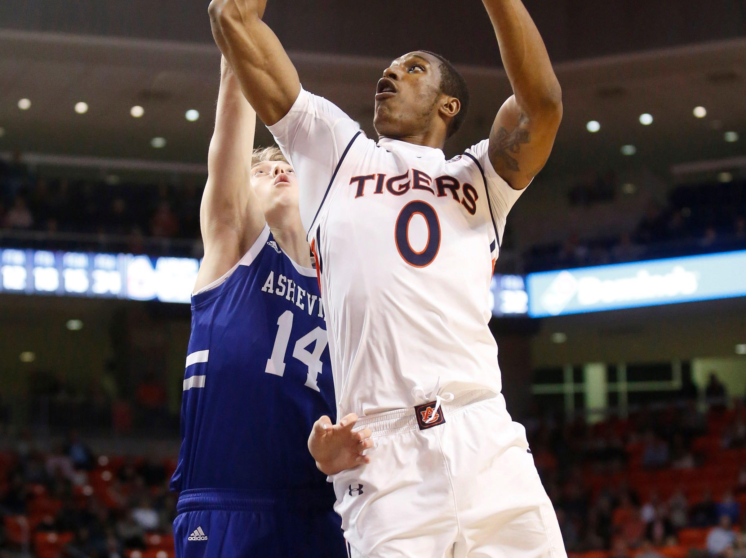 Dec 4, 2018; Auburn, AL, USA; Auburn Tigers forward Horace Spencer (0) shoots over UNC-Asheville Bulldogs forward Luke Lawson (14) during the second half at Auburn Arena. Mandatory Credit: John Reed-USA TODAY Sports