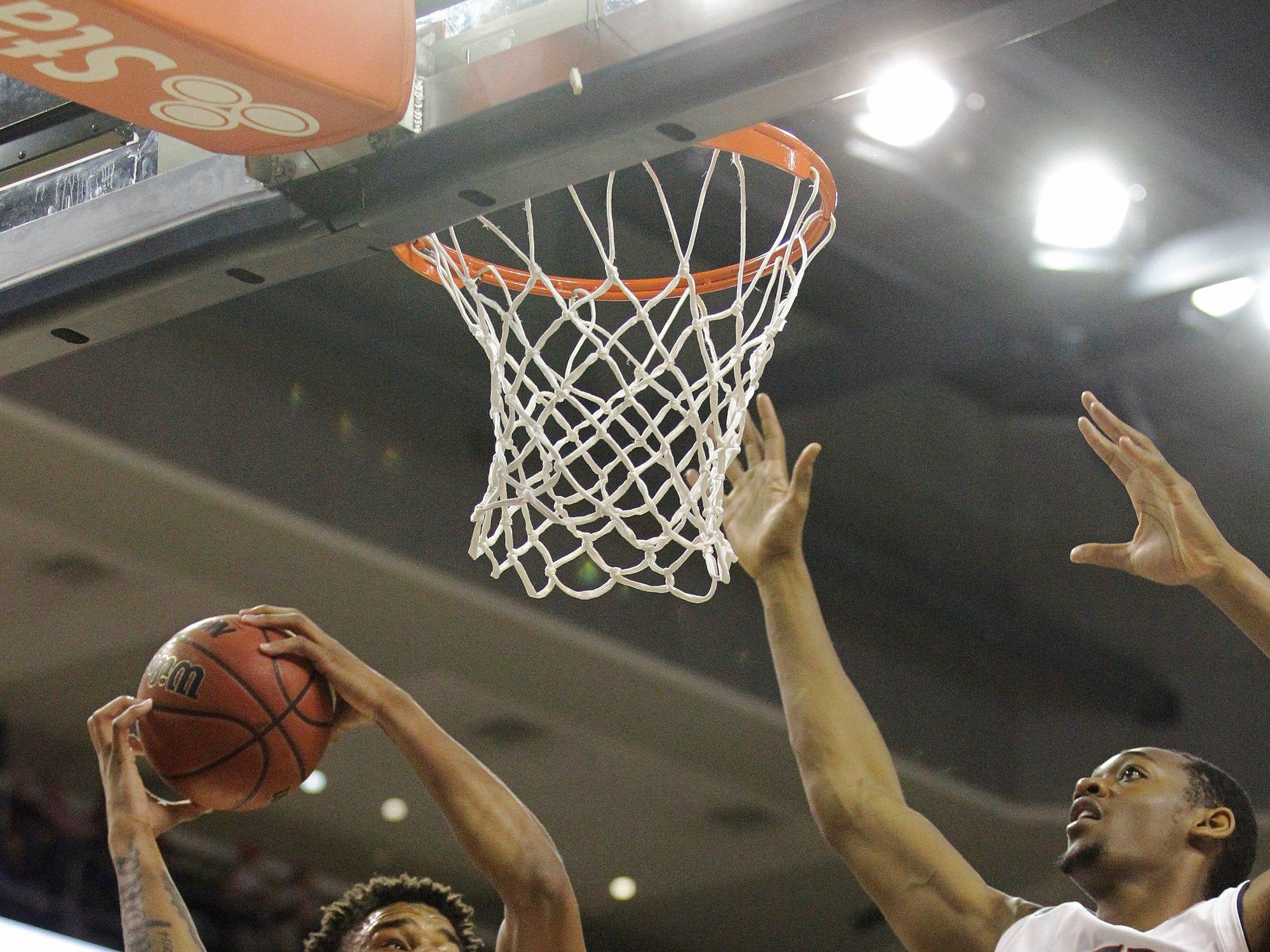 Dec 4, 2018; Auburn, AL, USA; Auburn Tigers forward Chuma Okeke (5) grabs a rebound from center Austin Wiley (50) during the first half against the UNC-Asheville Bulldogs at Auburn Arena. Mandatory Credit: John Reed-USA TODAY Sports