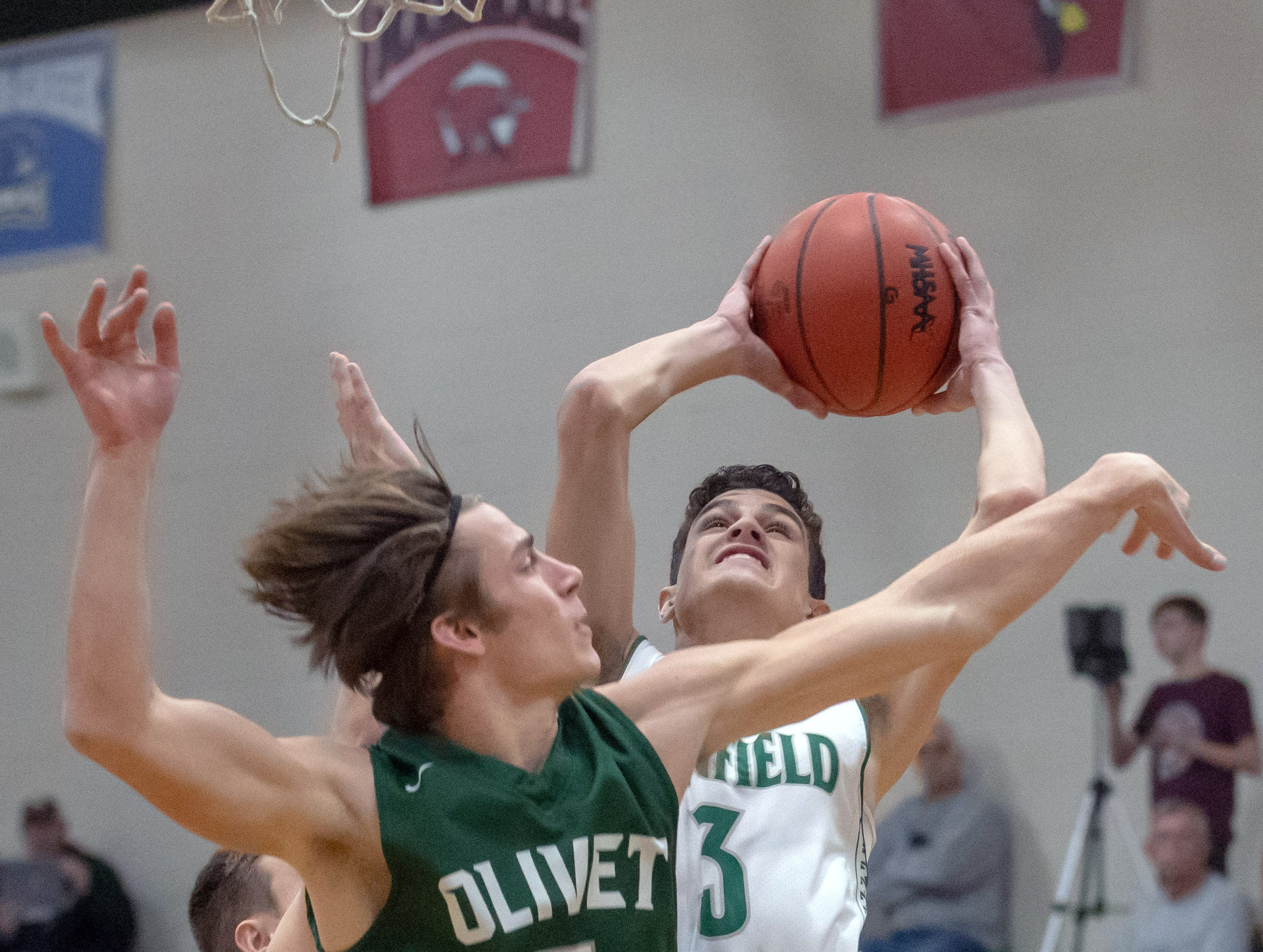 Pennfield's Gavin Liggett (3) gets past a Olivet defender as he tries for two points during game action Tuesday night.
