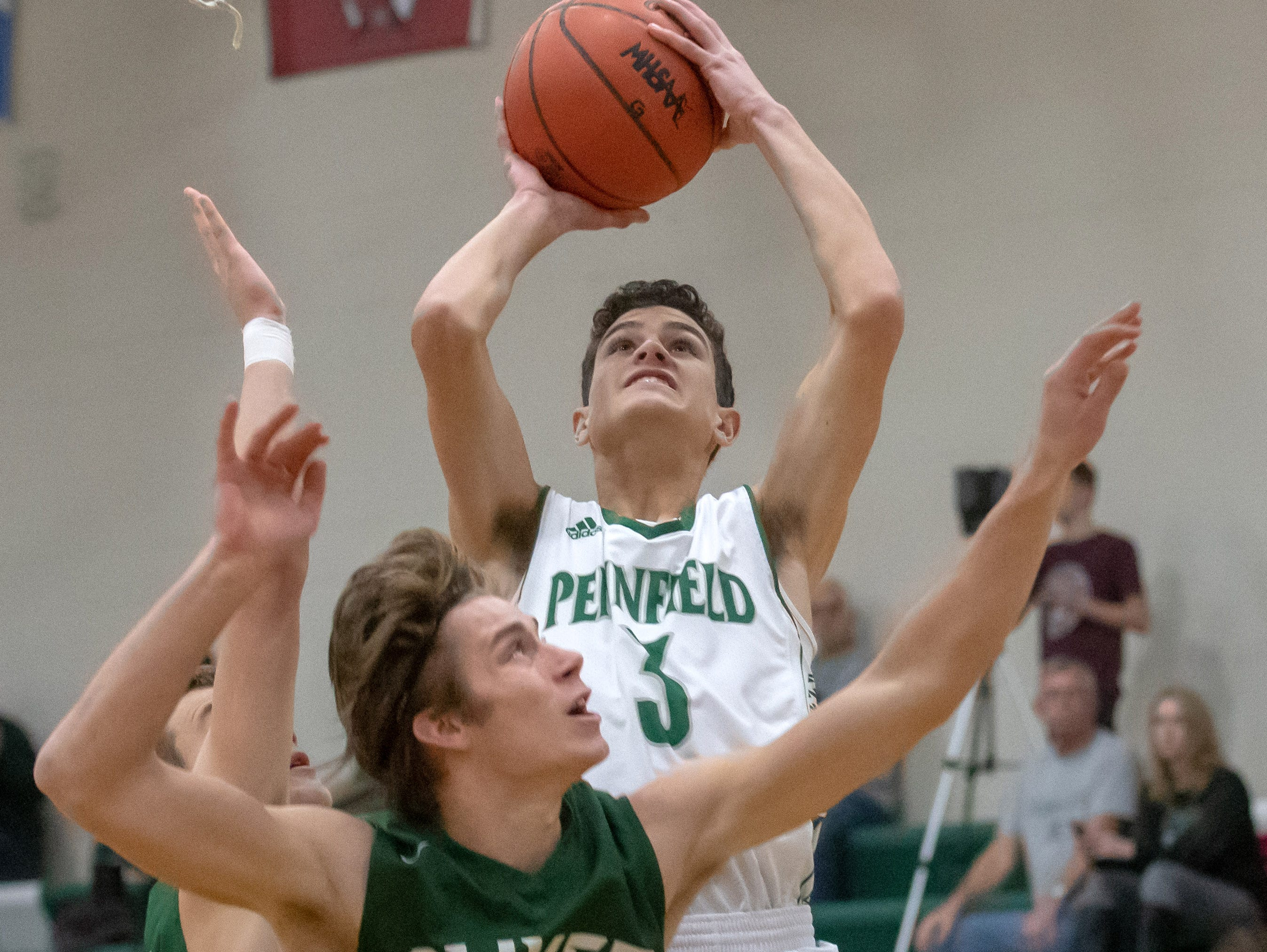 Pennfield's Gavin Liggett (3) tries for two points during game action Tuesday night.