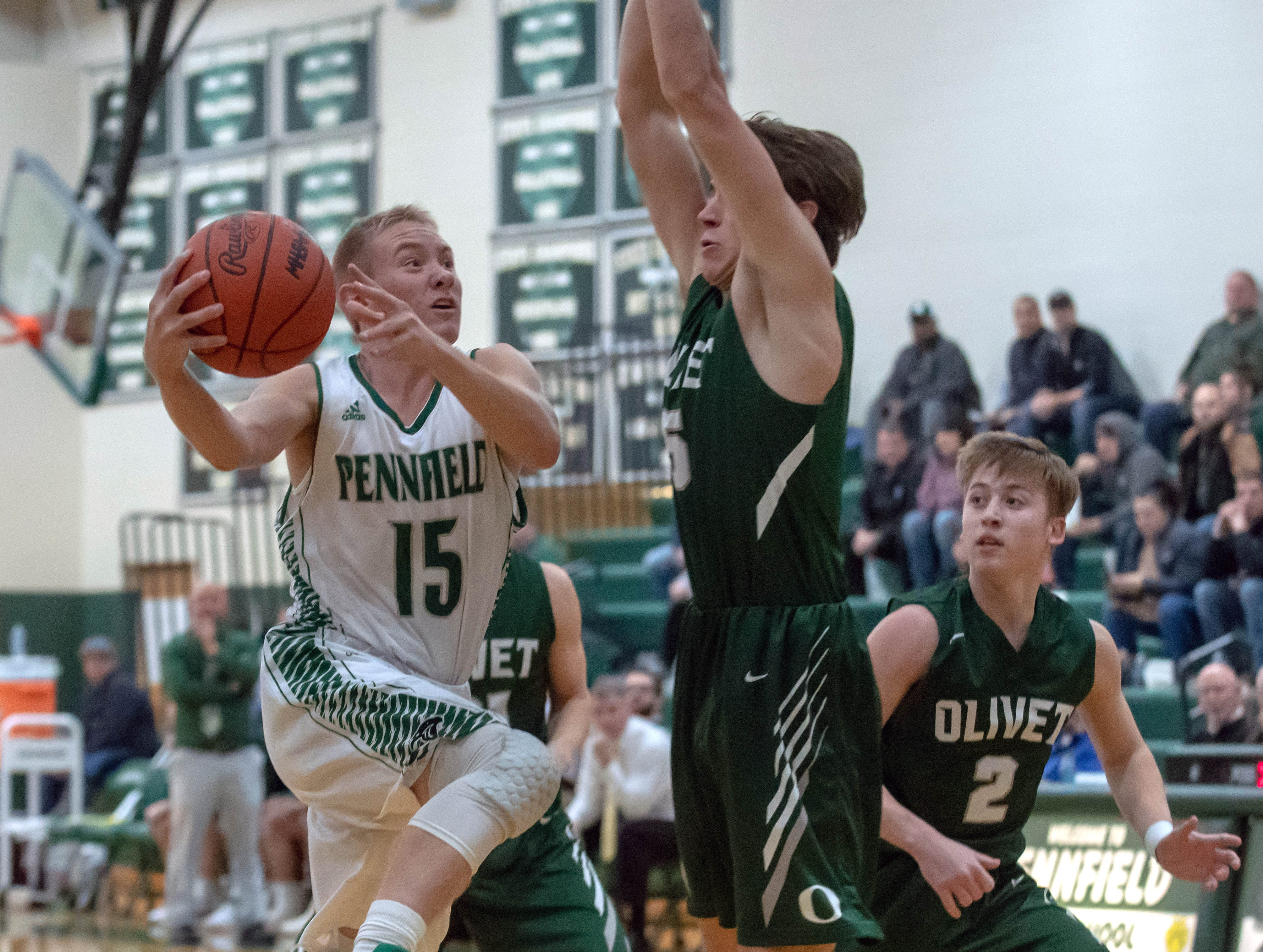 Pennfield's Keagan Burns (15) drives the basket during game action Tuesday night.