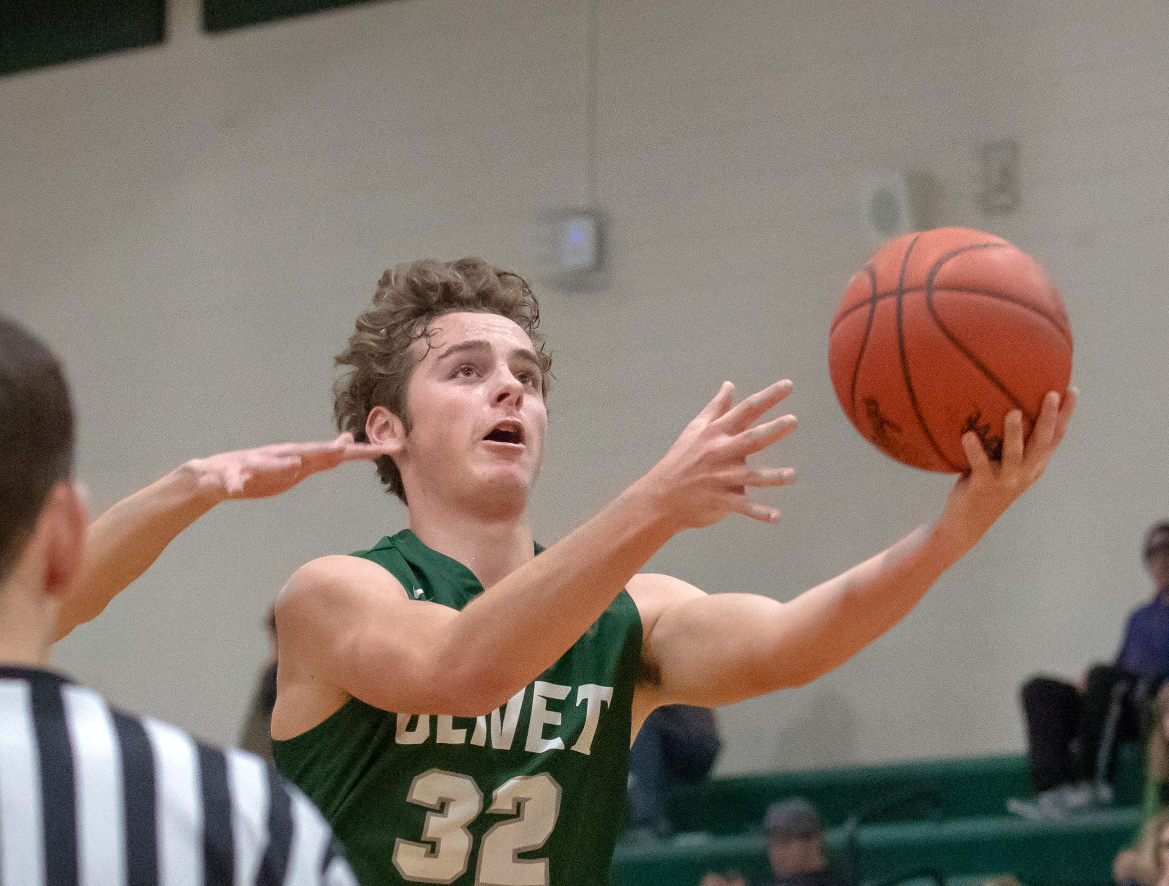 Olivet's Sam Heston (32) tries for two points during game action Tuesday night at Pennfield.
