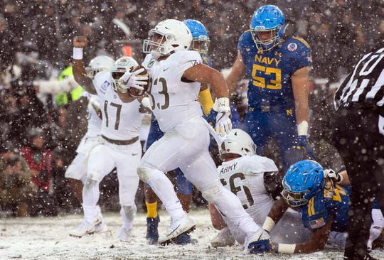 Darnell Woolfolk's favorite game with the Army Black Knights? Running for a touchdown and beating the Midshipmen in the snow in 2017.