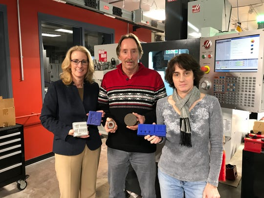 From left, SUNY Broome Dean of STEM Michele Snyder, associate professor Dirk Elliot and computer science professor Diana LaBelle show some of the materials that can be made at the Calice Center's Advanced Manufacturing Lab.