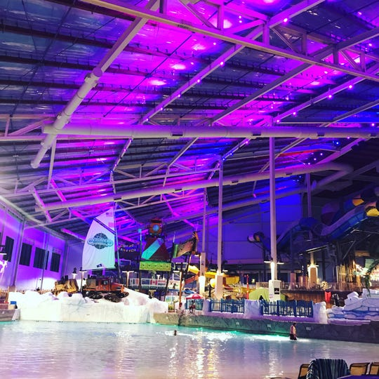 At nighttime, the lights are dimmed at Aquatopia Indoor Waterpark at Camelback Resort.