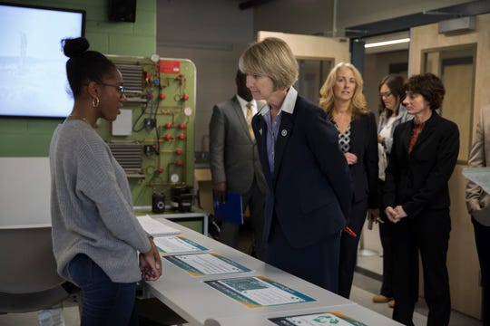 SUNY Chancellor Kristina Johnson learns about what the Paul and Mary Calice and Mildred Barton Advanced Manufacturing Center at SUNY Broome can offer during its official opening in October.