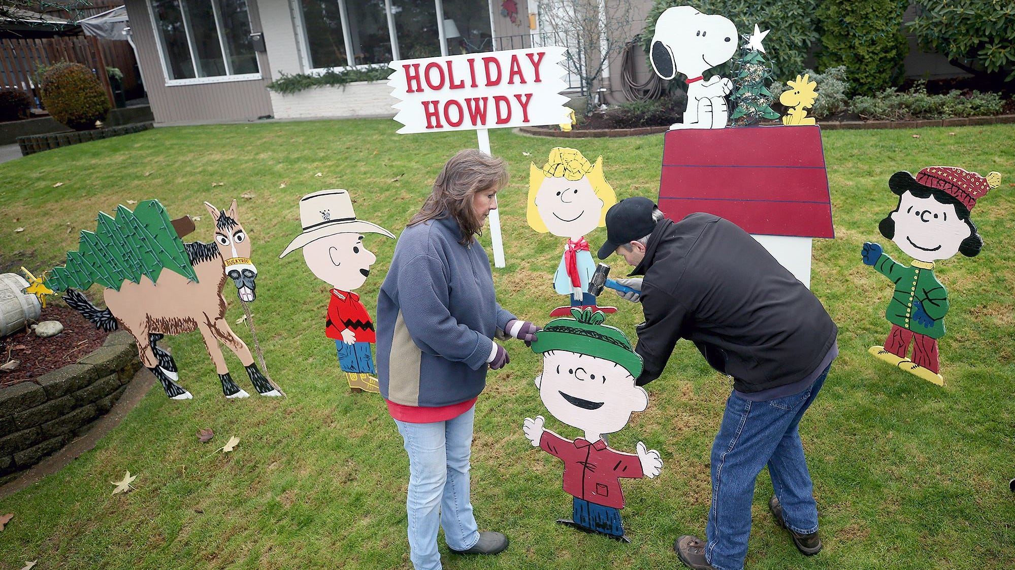 """Michelle and Rich Adamski put up their annual """" Peanuts"""" characters Christmas display at the East Bremerton home on Friday, November 23, 2018. Rich made the popular figures."""