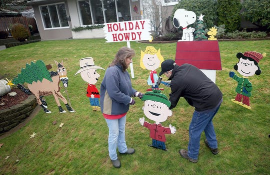 "Michelle and Rich Adamski put up their annual "" Peanuts"" characters Christmas display at the East Bremerton home. Rich made the popular figures."