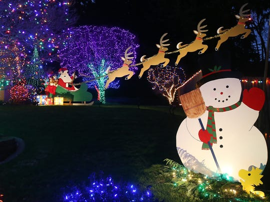 Santa, reindeer and a snowman also adorn Michelle and Rich Adamski's Sunrise Drive lawn in Bremerton.