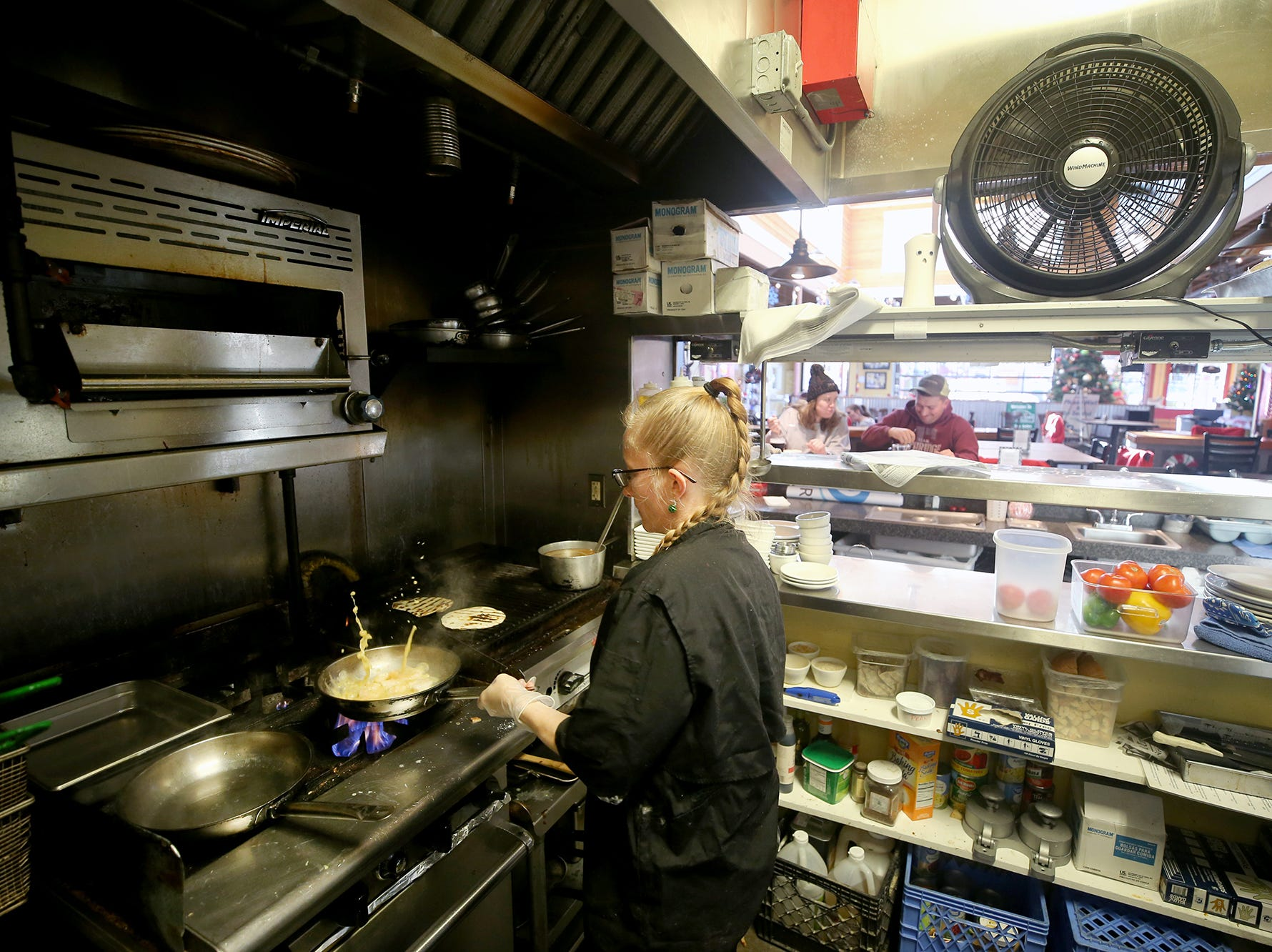 Cook Heather Farrell makes shrimp tacos at The Dock Bar & Eatery in the Port Orchard Market.