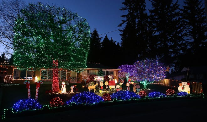 The lights and Peanuts character cutouts shine brightly at Rich and Michelle Adamski's Sunrise Drive home in Bremerton.