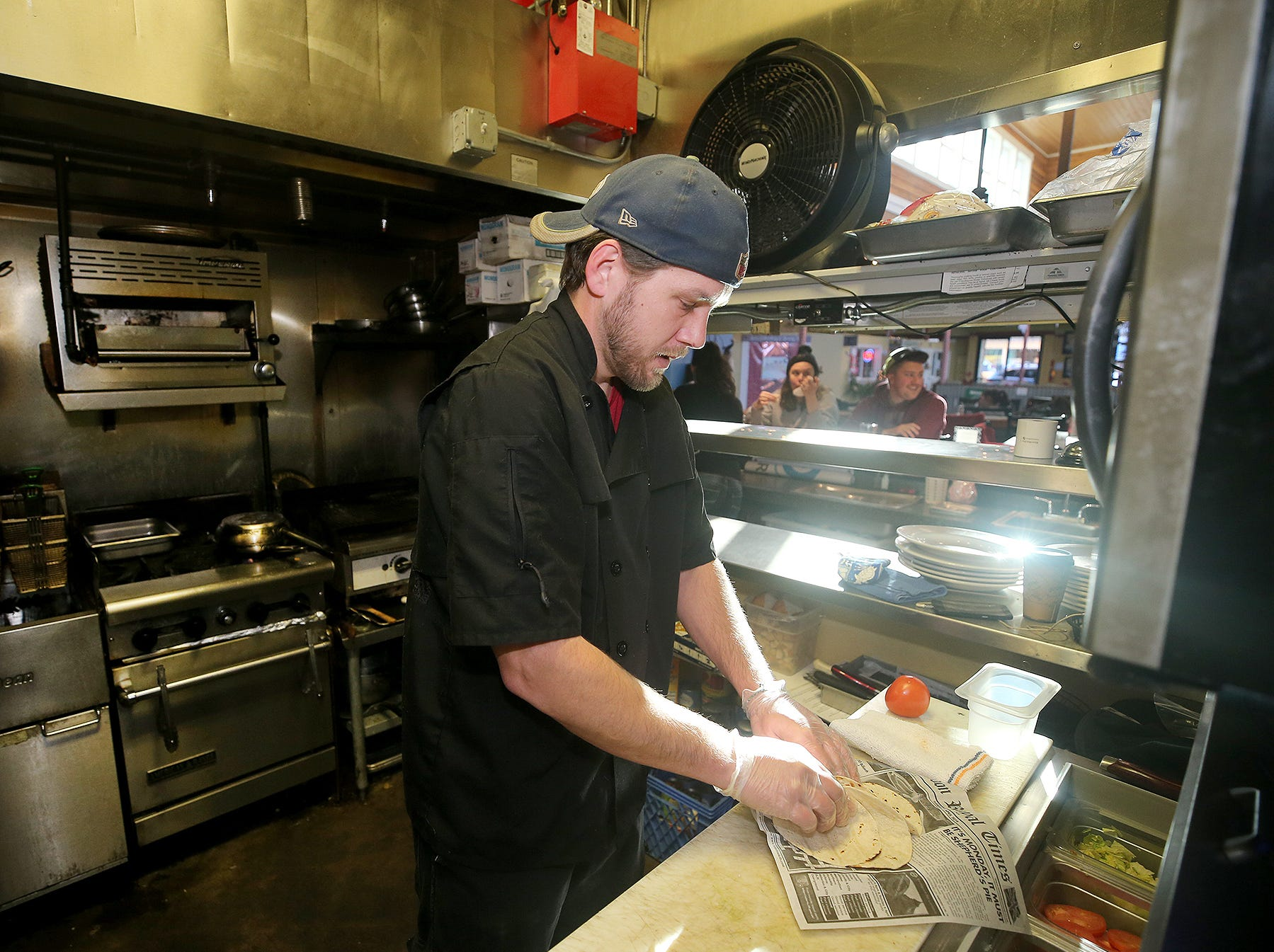 Chef Ian Buol makes a seafood taco at The Dock Bar & Eatery in the Port Orchard Market. The tacos are a popular item.