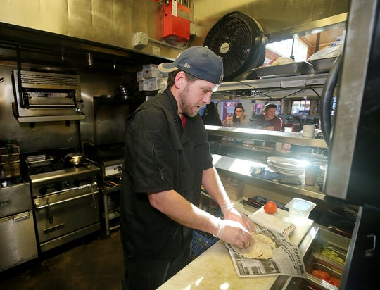 Chef Ian Buol makes a seafood taco at The Dock Bar & Eatery in the Port Orchard Market.