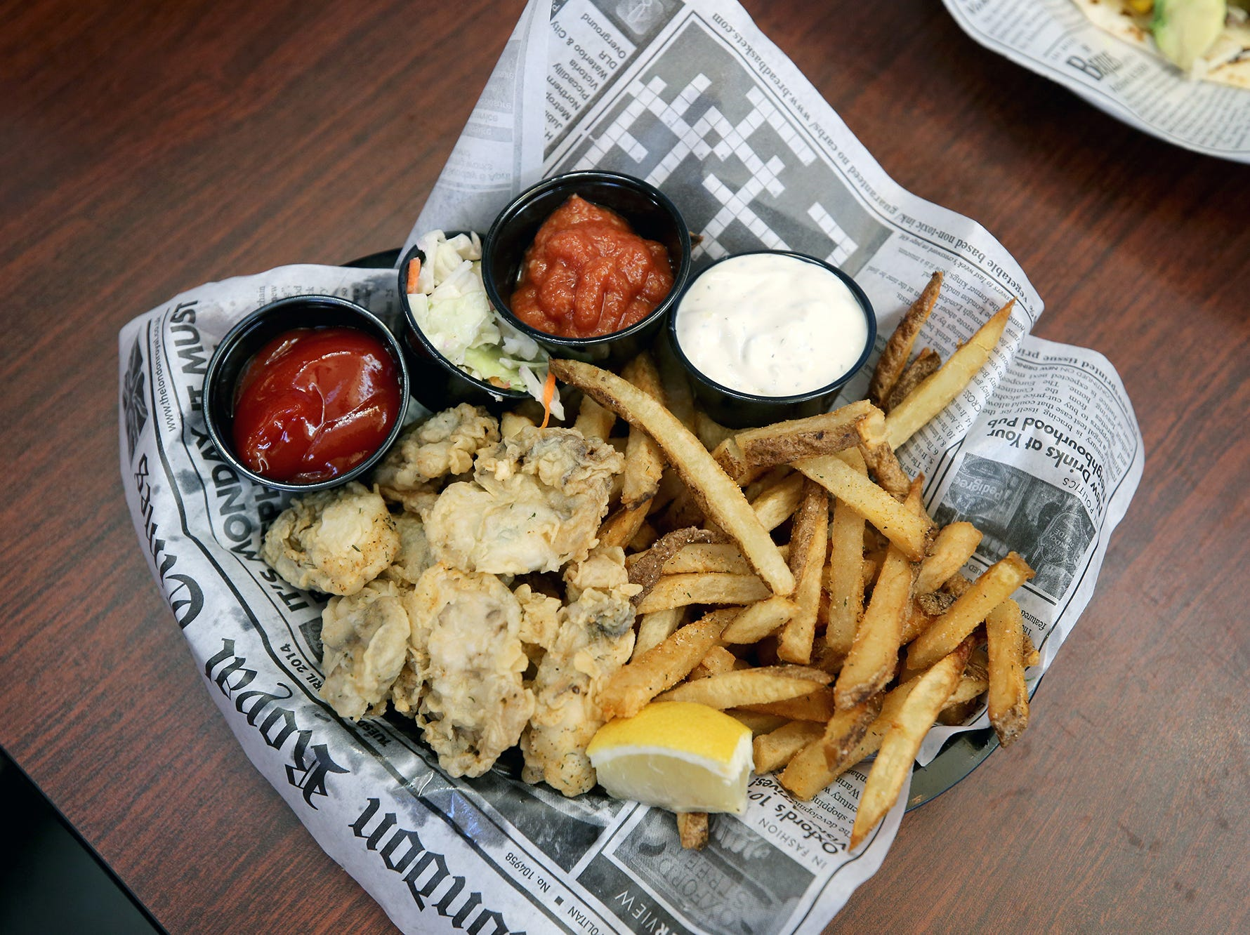 Food in a basket with a paper at The Dock Bar & Eatery in the Port Orchard Market.