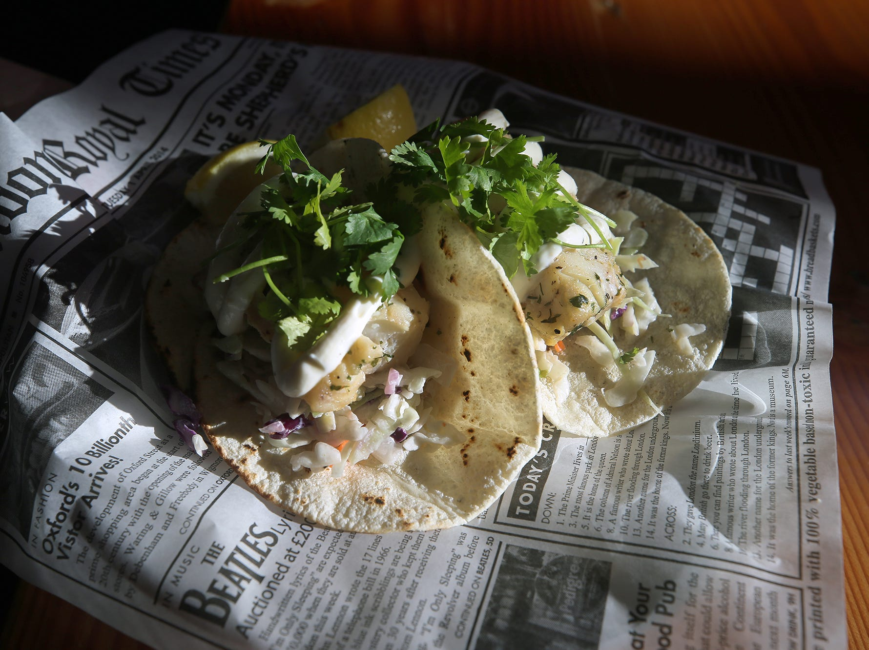 The Dock Bar & Eatery in the Port Orchard Market. Features fresh cod tacos wrapped in paper.