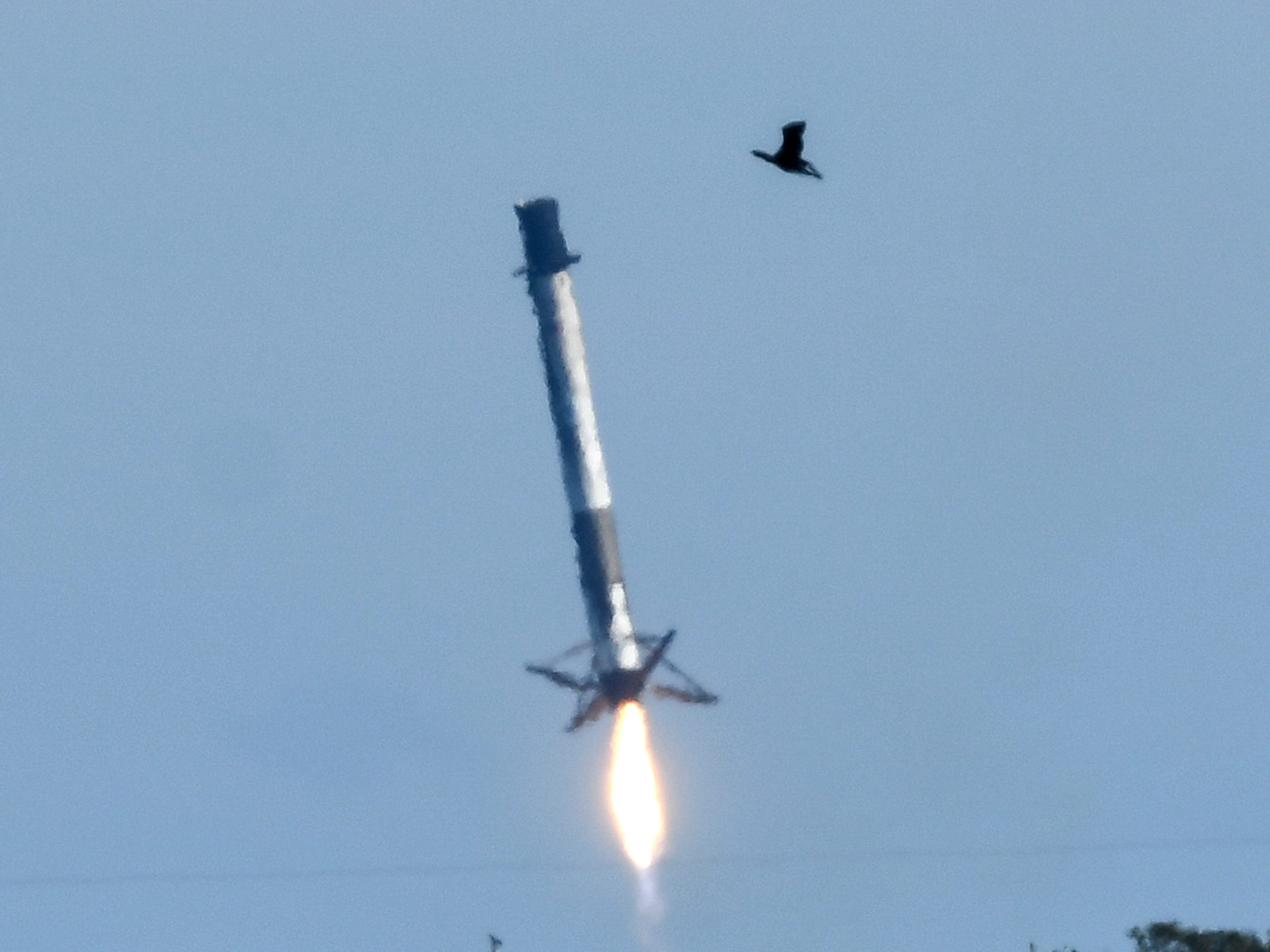 A SpaceX Falcon 9 first stage comes down for landing in the ocean off Cape Canaveral Air Force Station Wednesday, Dec.5, 2018. The rocket delivered it's cargo to orbit but landed off target.