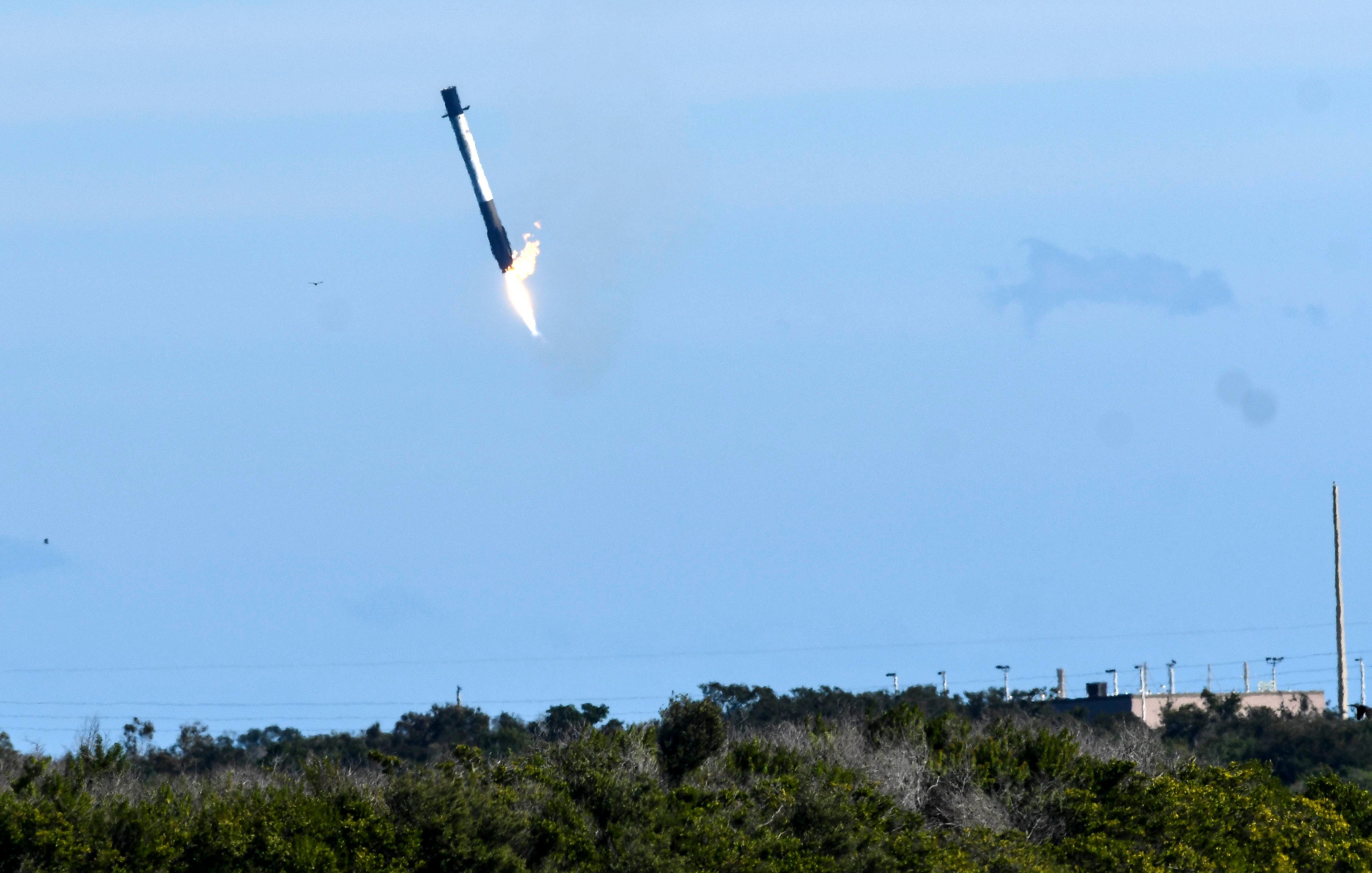 A SpaceX Falcon 9 first stage comes down for landing in the ocean off Cape Canaveral Air Force Station Wednesday, Dec. 5, 2018. The rocket delivered its cargo to orbit but landed off target.