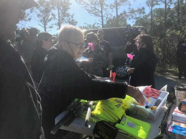 A team of volunteers and cadaver dogs marked areas in Palm Bay woods Dec. 5, 2018, during a search for the remains of missing firefighter Brandy Hall, who vanished in 2006.
