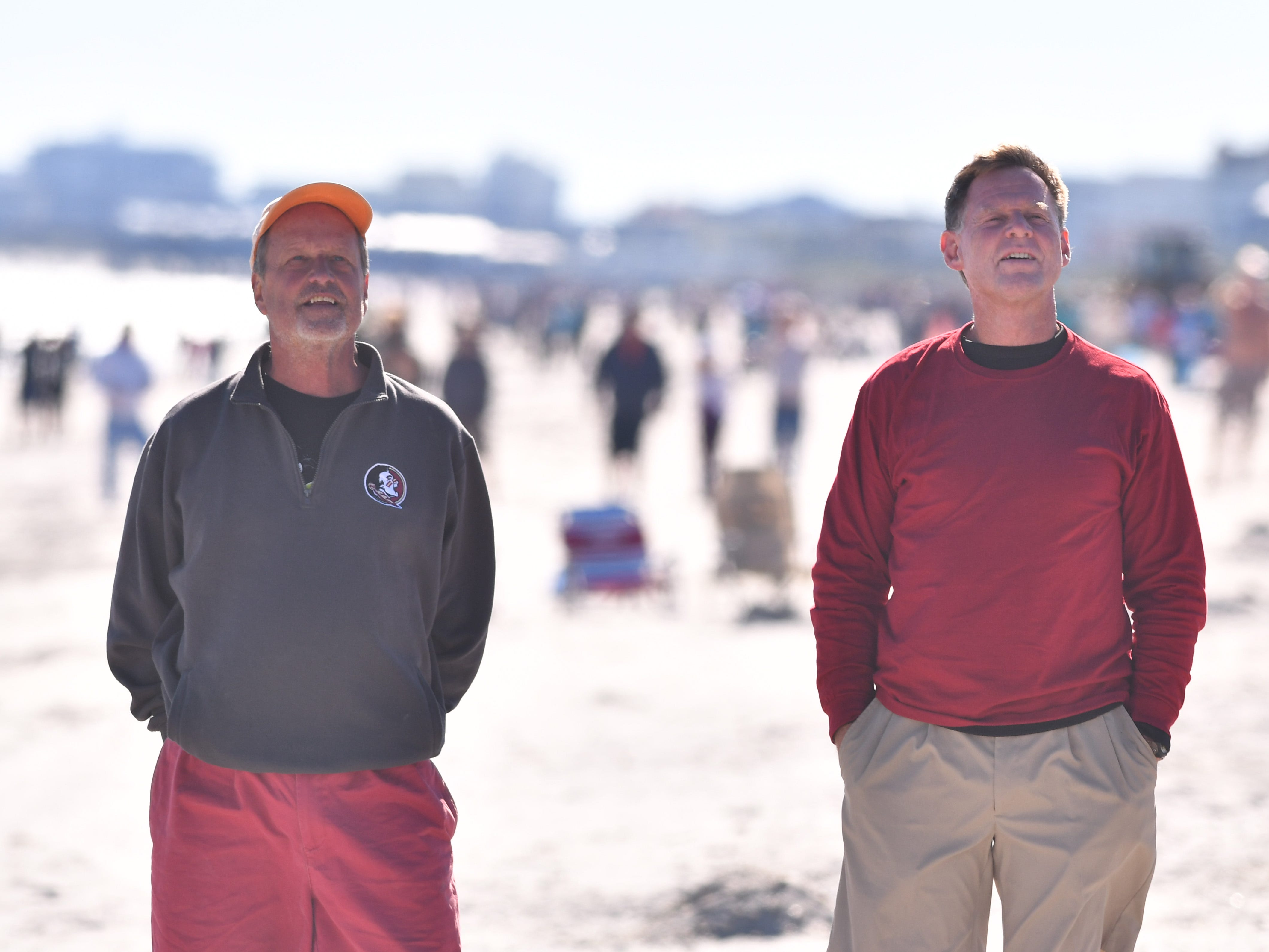 Kevin Scanlon and Dave Langenbach stand on the beach in Cape Canaveral and watch the launch of the SpaceX Falcon 9 from Cape Canaveral Air Force Station Launch Complex 40 Wednesday afternoon at 1:16 p.m. The Dragon spacecraft is carrying food, supplies and experiments to the International Space Station. The 156-foot-tall booster with landing legs deployed attempted to landed at Landing Zone 1 at Cape Canaveral Air Force Station roughly eight minutes after liftoff but landed in the ocean due to a hydraulics issue.