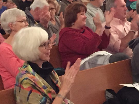 Marge Hamrell, who oversees the Westford Music Series, applauds during a concert by Frevo on Nov. 4, 2018.