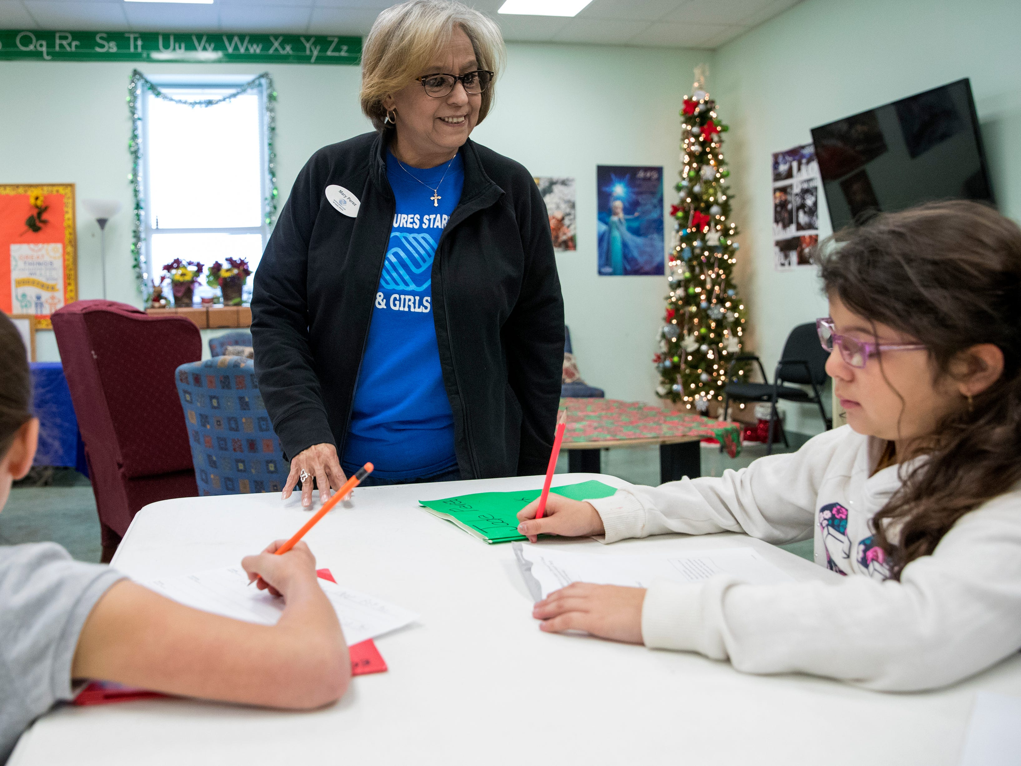 Aliyah Leija (left), 6, and Jada Perez (right), 6 get help with their homework from Mary Lopez, education programs lead at the Boys & Girls Club of Alice, on Tuesday, December 4, 2018. Programs at the club focus on education, life skills and recreation, such as art and games. They rely on donations to maintain and improve facilities. The Boys & Girls Club of Alice is one of seven agencies who participate in the Caller-Times Children's Christmas Appeal.