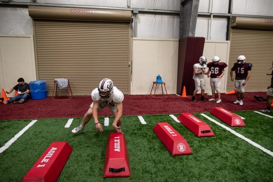 Calallen players run drills during practice as they prepare for the state quarter finals.