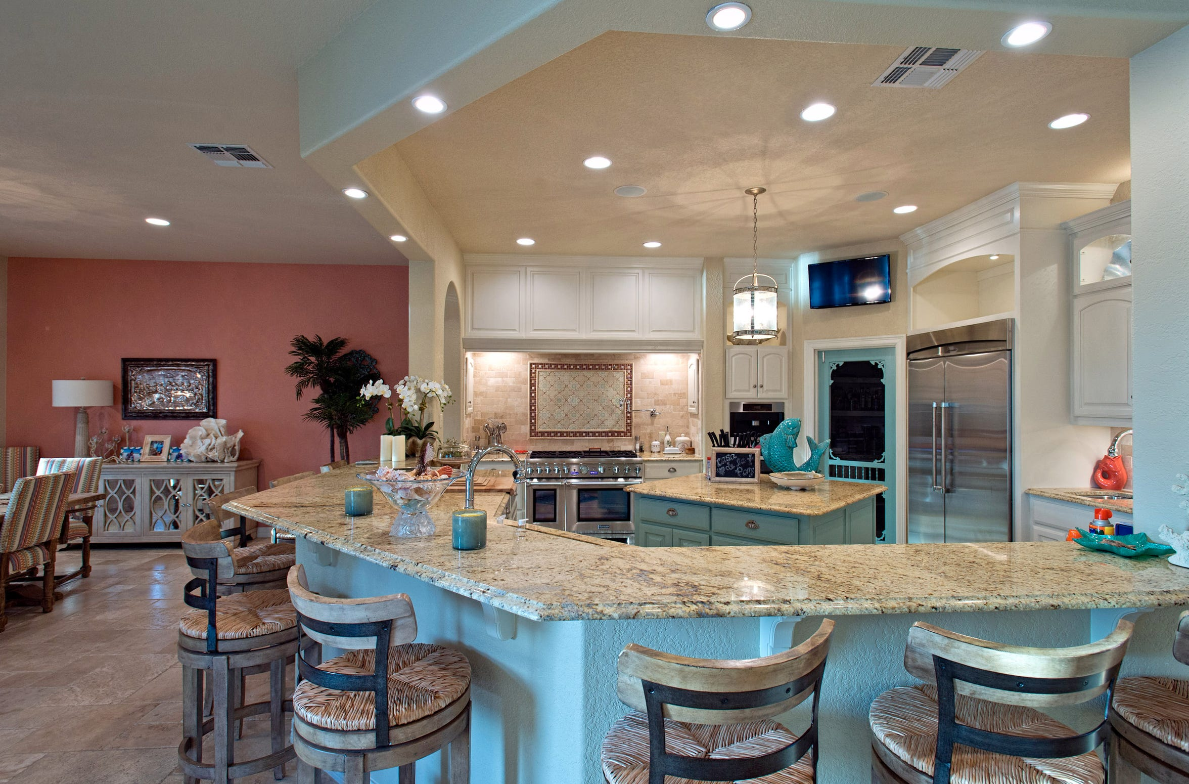 The large and open gourmet kitchen includes many must have features, such as Thermador stainless steal appliances, a commercial style gas stone, subzero refrigerator, ice maker, wine chiller and a Miele built-in coffee maker