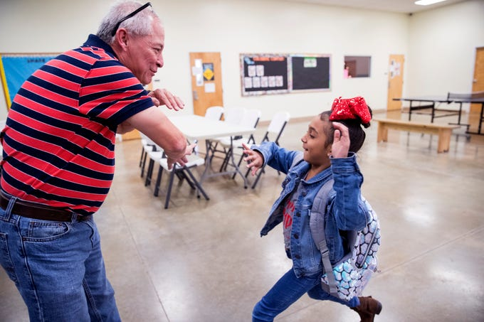 Rick Del Bosque greets Laci Ruiz, 7, as she arrives at the Boys & Girls Club of Alice on Tuesday, December 4, 2018. Del Bosque, executive director of the club, has taught the kids a high-five routine and greets them with it as they arrive for the day. The Boys & Girls Club of Alice is one of seven agencies who participate in the Caller-Times Children's Christmas Appeal.