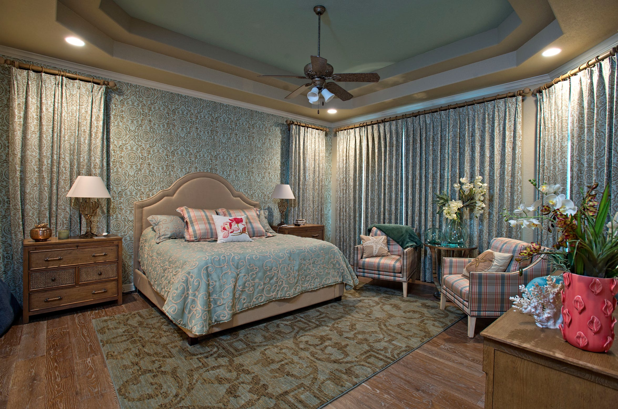 The dreamy ultra relaxing master bedroom has luxurious drapes and restful tones for a great night's sleep.